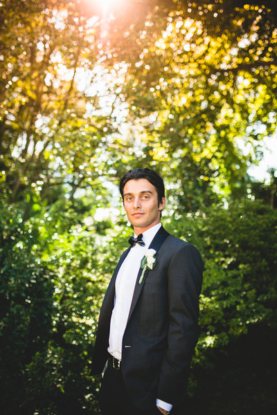 italian groom in tuxedo with ceramic bow tie at lake como wedding