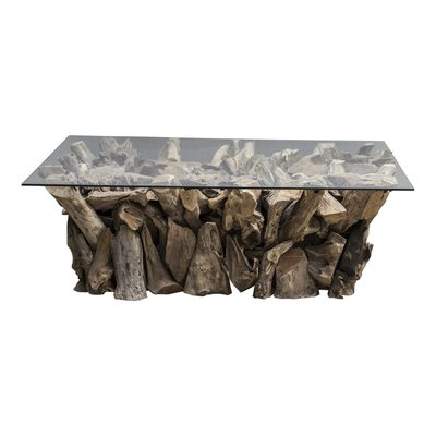 Natural coffee table with compiled tree roots as the base and a rectangular glass top from Hockman Interiors