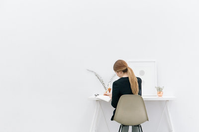 Canva - Woman Working in a Minimalist Office Space