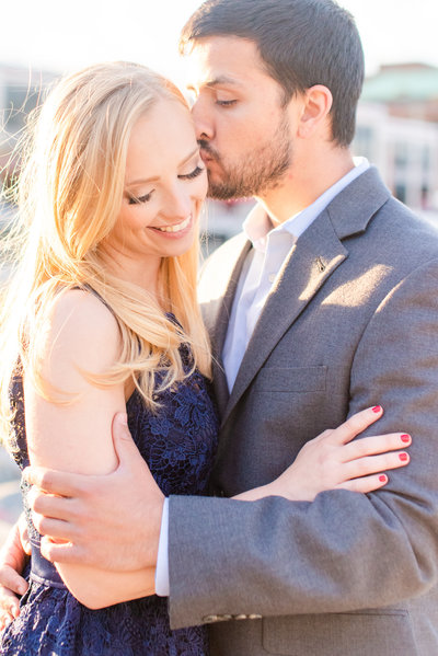 Groom twirling his fiancee at their engagement session outside the US Capitol building