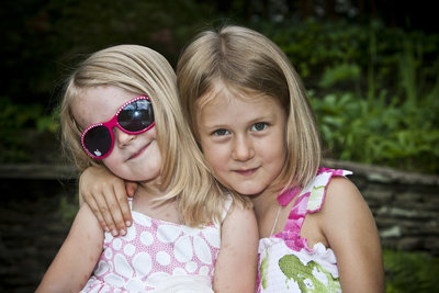 Sisters and best friends hug and smile for the camera at Vines Botanical Garden in Gwinnett County