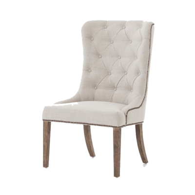White dining chair with upholstered fabric, studded details, and natural wood legs from Hockman Interiors