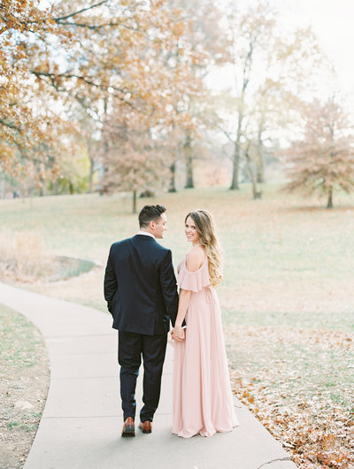Bride and Groom take each other's hand during a romantic first look