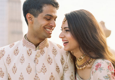 indian bride and groom smiling