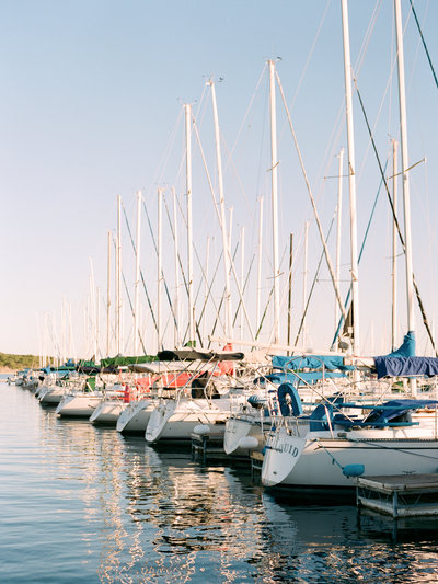 Texas based wedding photographer traveling to capture the beautiful sceneries the world has to offer. In this image, boats at a Texas Yacht club are lined up along the docks.