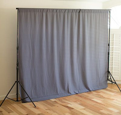 simple & attractive gray fabric backdrop that goes with everything