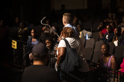 A woman is miraculously healed at Festival of Life in Newark, NJ after Evangelist Jonathan Shuttlesworth prays for her