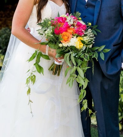 Garden style wedding bouquet with peonies and garden roses