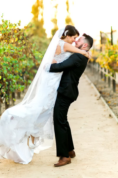 Picture of couple on wedding day at Turnip Rose in Costa Mesa wedding vineyards