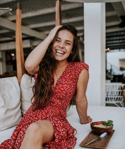 Photo of Evie Rupp in Bali, Smiling as she talks about building wealth as a faith-based business owner on The Jo Show Marketing Strategies Podcast