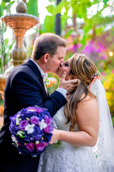 San Diego bride and groom kissing at Grand Tradition Wedding Estate