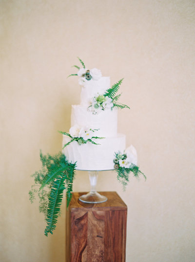white wedding cake with floral arrangements