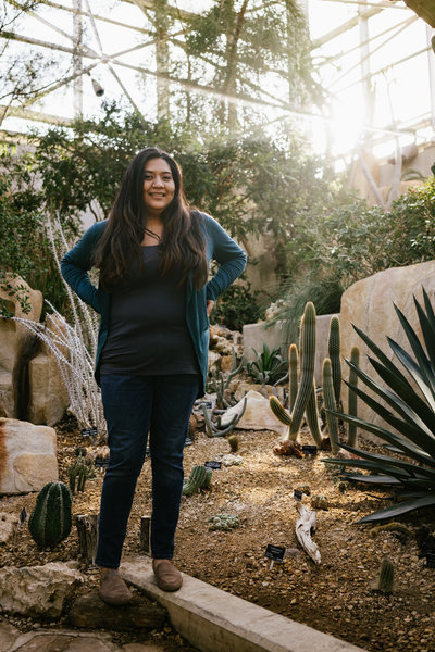 San Antonio Photographer Irene Castillo posing with succulents for instagram picture @irenesplanit