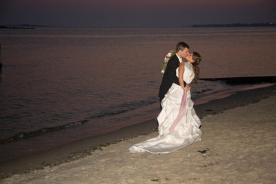 wedding couple kissing on beach