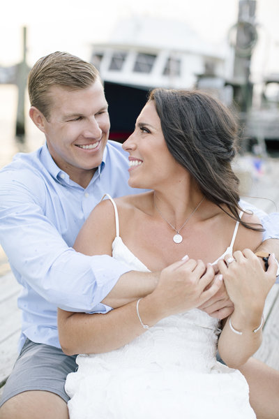 engagement session couple on dock in summer