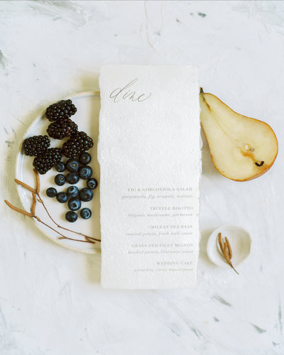 Simple and minimal wedding menus on handmade paper for a beach wedding by Plume & Fete