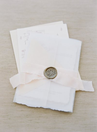Plume & Fete wedding invitation embellishments vellum wrap silk ribbon and wax seal