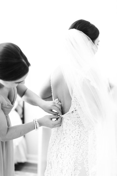 black white photo of bride getting ready