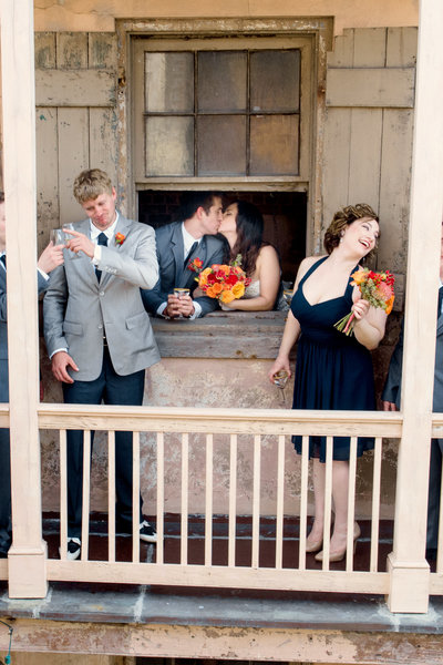 New Orleans wedding couple kissing in window