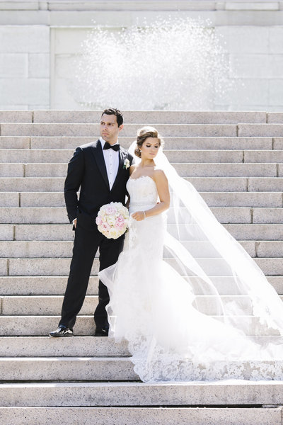 bride and groom on grand staircase outside