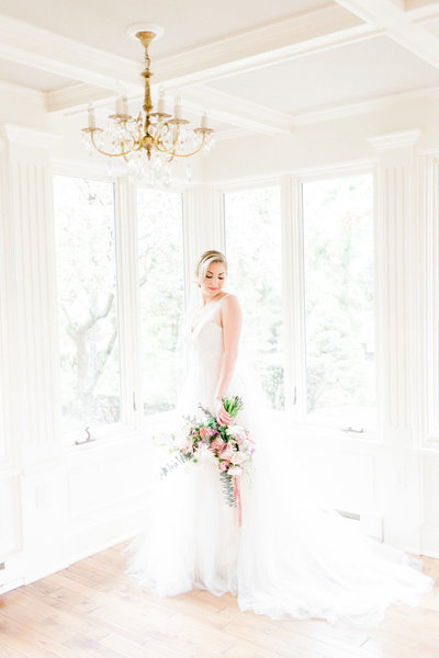 Bride in sunroom at Linwood Estate