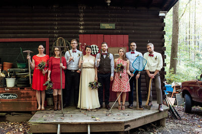 wedding party poses for portrait rustic and outdoors