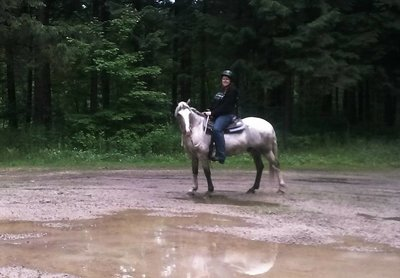 Casi trail riding in the Machickanee forest on her Spanish Mustang, Scout.