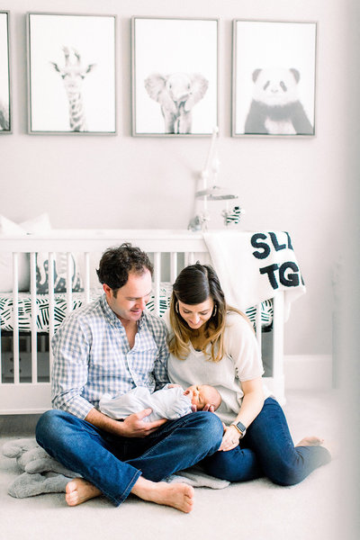 A Holly Springs in-home newborn photography session with Mom, Dad and newborn baby boy.