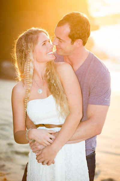 Couple embracing during a beautiful sunset at the beach in La Jolla taken by ABM Photography