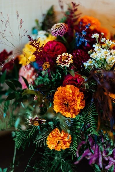 Colorful fall wedding flowers at Bear Mountain Inn in the Hudson Valley. Hudson Valley wedding florist