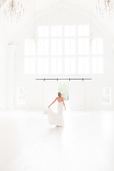 bride twirling in wedding dress at the white sparrow barn