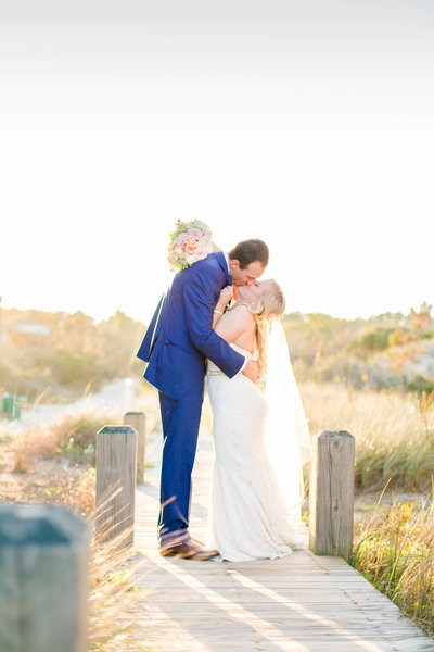 Corolla North Carolina wedding photographer bride and groom on pier