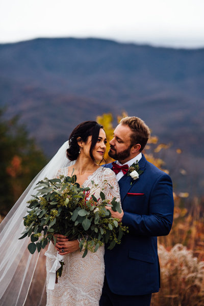 Wedding couple sharing moment together in the smokey mountains in Gatlinburg during portraits