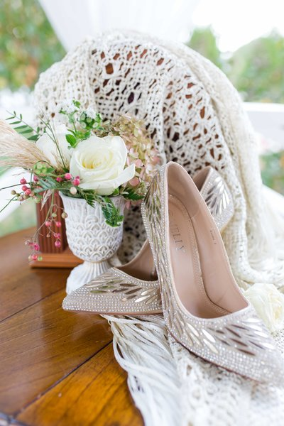 Great gatsby themed wedding details with bouquet and bridal shoes
