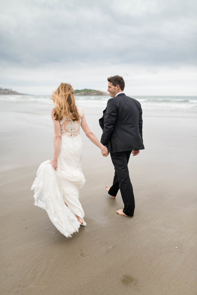 Married Couple Walking on the beach hand in hand