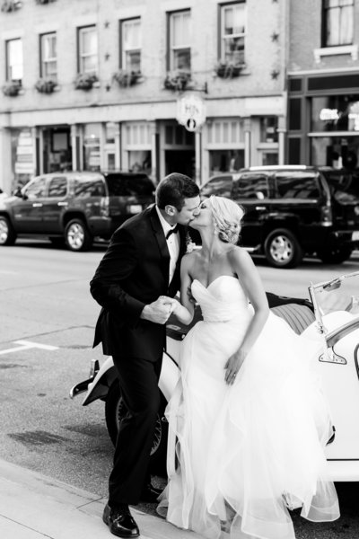 Bride and Groom Kissing on a street