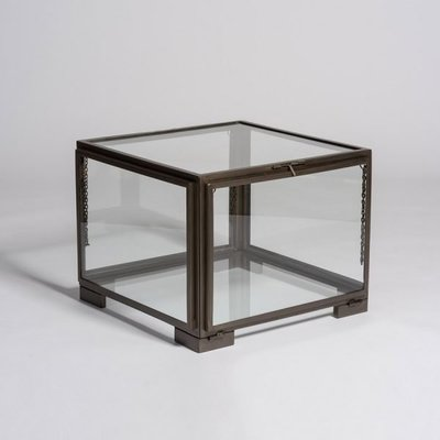 Cube-shaped coffee table with glass, sold at Hockman Interiors