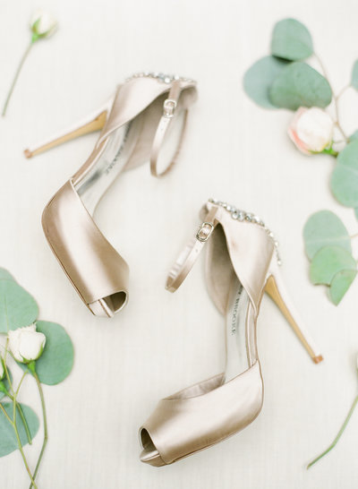 Gold bridal shoes detail shot