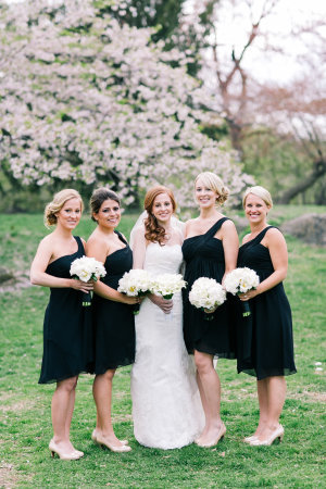 Bridesmaids with bride in Cherry Blossom tree