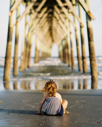 child on sitting  on beach