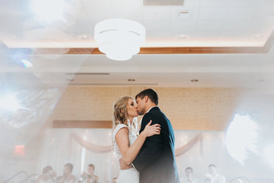 Bride and groom dance their first dance at the Hilton Garden Inn in Cedar Falls, IA