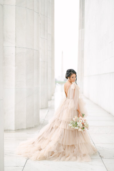 bride in blush dress at lincoln memorial in washington dc by costola photography