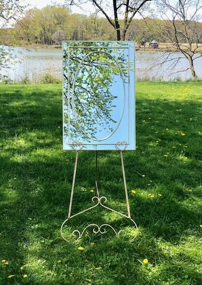 gold easel with mirror