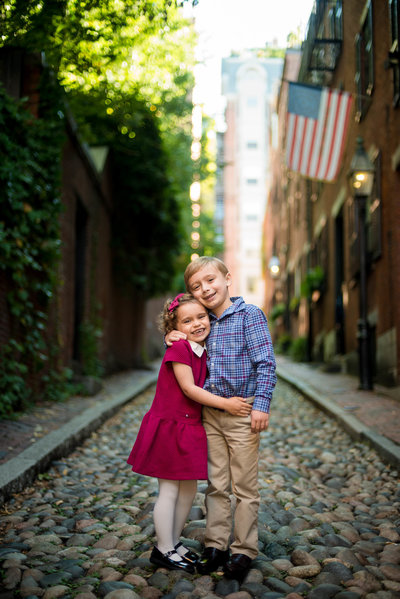 brother and sister hugging acorn street beacon hill family session