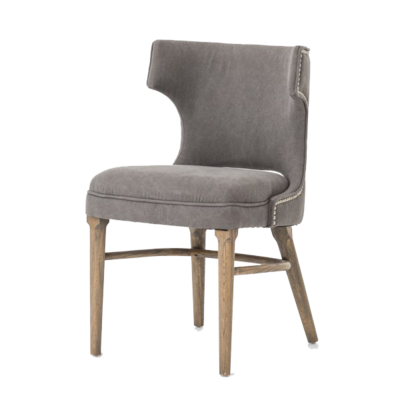 Hockman Interiors grey sideless dining chair with studded embellishment on backside and wooden legs