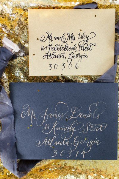 Great gatsby themed black and gold invitations on gold sequins