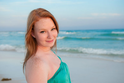 Red head senior girl standing on the beach in Florida
