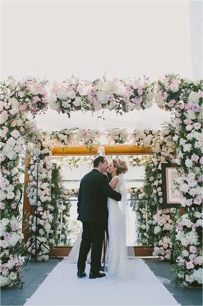 flower filled chuppah for jewish ceremony