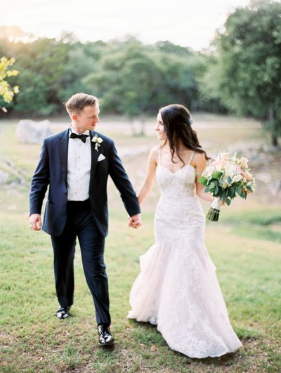 Kendall Plantation Film wedding in August. Bride and Groom walking.