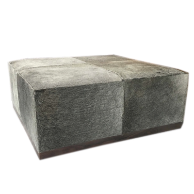 Soft square ottoman with grey tones from Hockman Interiors